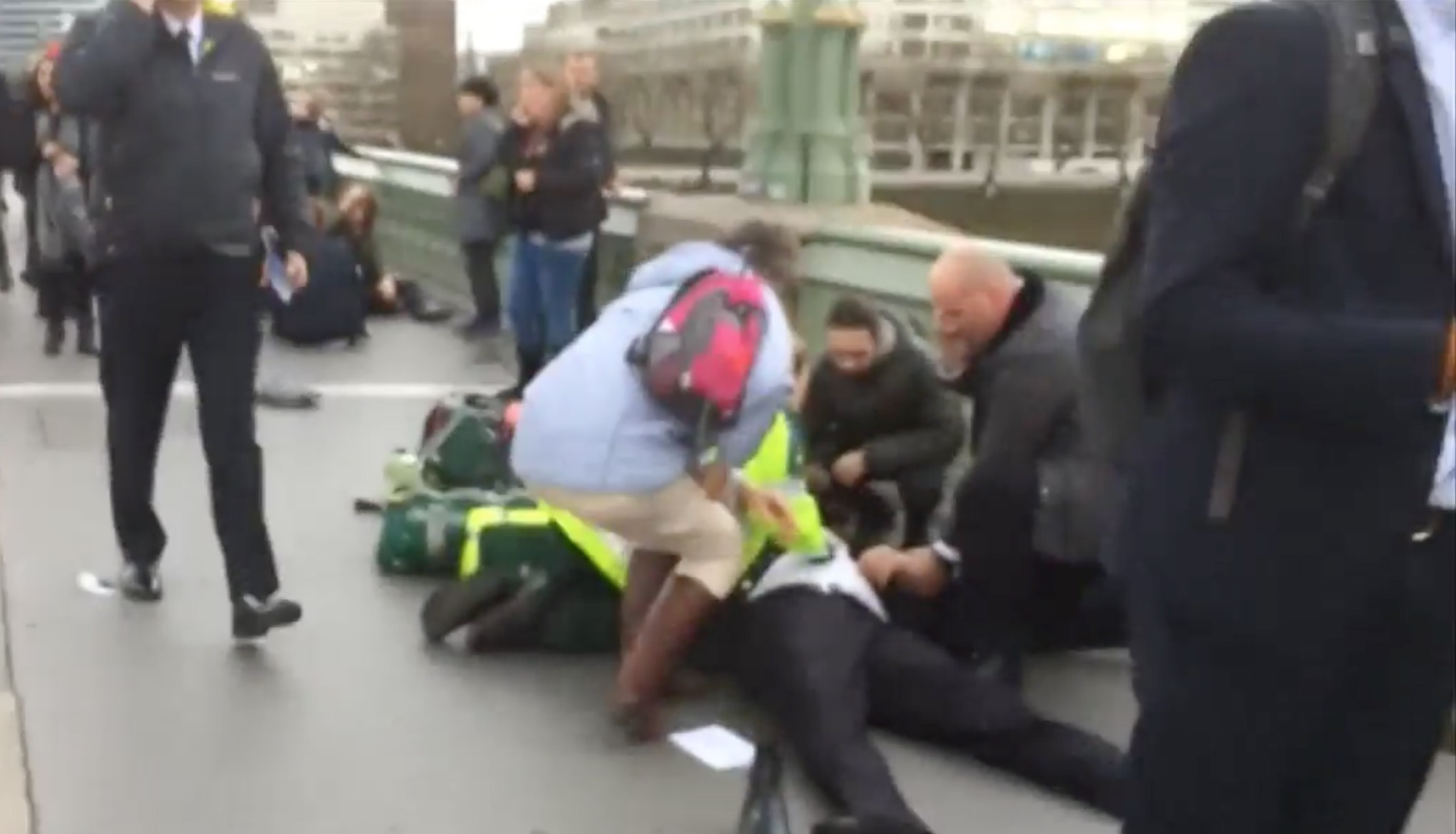 People trying to help the around 20 people who were hit by the terrorist's car on Westminster Bridge.